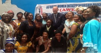 AWEP-L's Ambassador Rugie Barry (5th from R) and her Team post for photo with CHEVRON's Supply Chain Manager, Mr. Weaver after the signing ceremony