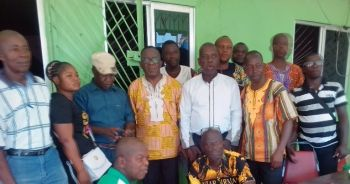 Minister Tarph( middle with glasses) flanked by Nimba County Commerce Inspectors