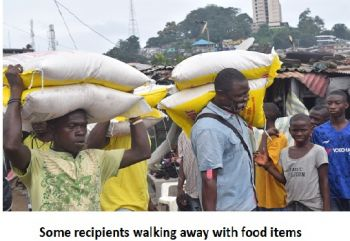 Some recipients walking away with food items